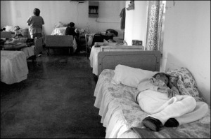 Carmelita Gutierrez takes a nap while a nurse visits with other residents at La Divina Providencia in Agua Prieta, Mexico Friday, November 2, 2007. (Photo: Courtney Sargent)