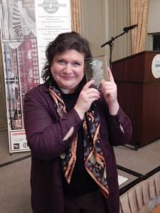 Marcela Zuchovicki, Jalima and Associates holding her award